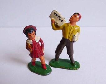Two Barclay lead figures Newspaper boy & Red dress girl w/ doll
