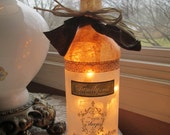 family bottles with lights,lighted wine bottles,decorated wine bottles,wine bottle lamps.lamp,lamps,glass lighted bottles,wine