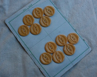 12 Vintage Yellow Buttons on a card