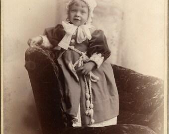 Antique Cabinet Photograph Cute toddler Big bow bonnet