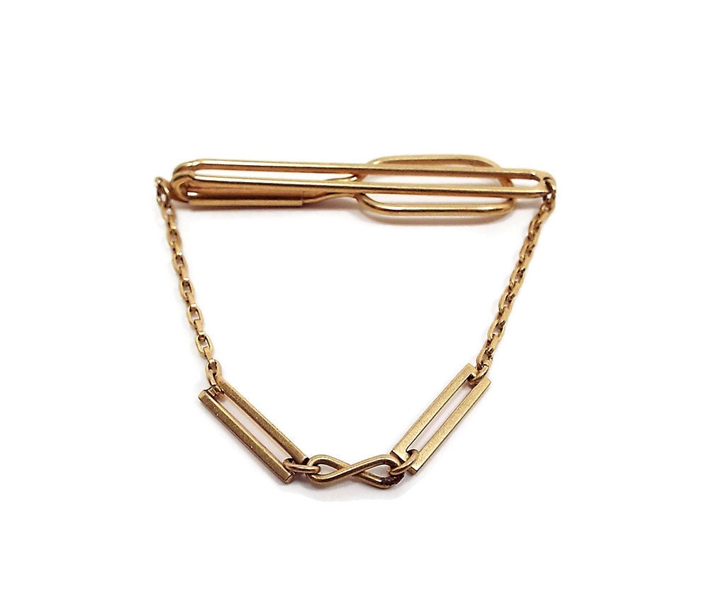 Swank vintage tie bar clasp cravat holder with chain gold tone for What is swank jewelry