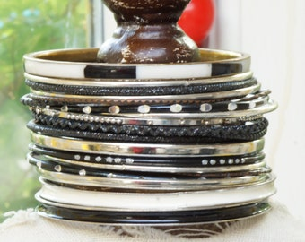 STACKING BANGLES - Mixed collection of stacking bangles - lovely mixture of more than 20 stacking bangles -black white silver bangles