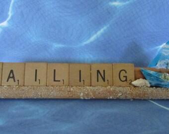 whimsical display paper boat beach shell sailing summer travel scrabble tile art