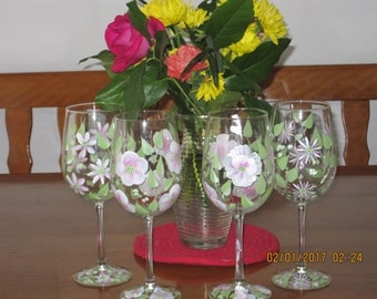 Wine glasses a set of four hand painted with pink and white Daisies, Pansies and wildflowers