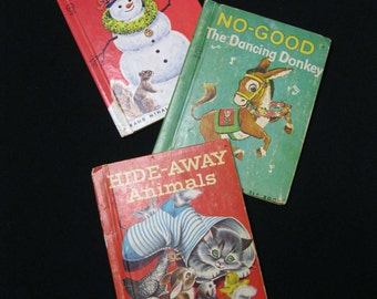 """Rand McNally Junior Elf Books, '44, '57 and 1977,  The Christmas Snowman, No-Good The Dancing Donkey, and Hide- Away Animals, 5"""" X 6.5"""""""