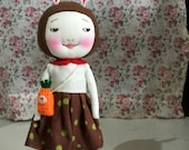 Handmade smiling bunny doll with carrot