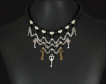 Classic Victorian drape necklace with a Steampunk spin made with genuine onyx beads and different keys by Sylvan Creations.