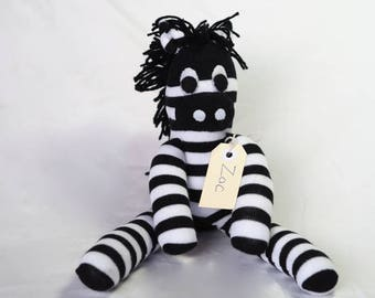 Sock animal, sock zebra, sock monkey, soft plush toy for children. Black and white. Zac Zebra.
