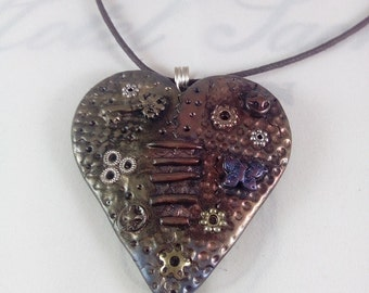 Copper/bronze coloured heart shaped steampunk polymer clay pendant, necklace