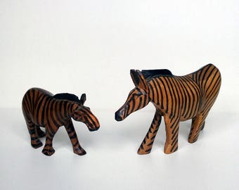 Vintage hand carved wooden zebra figurines made in Africa
