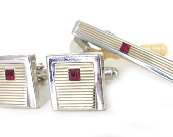 Don Draper vibe. Gorgeous grooved Anson red, silver and white cufflinks and tie bar set. White faces with red crystal inset. Automotive look