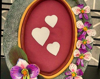 Oval Frame with orchids