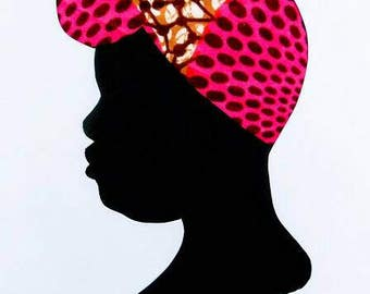 Female silhouette in pink and orange African print fabric cut paper art