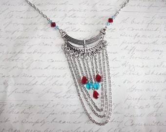 Chain cascade necklace with red and blue crystals