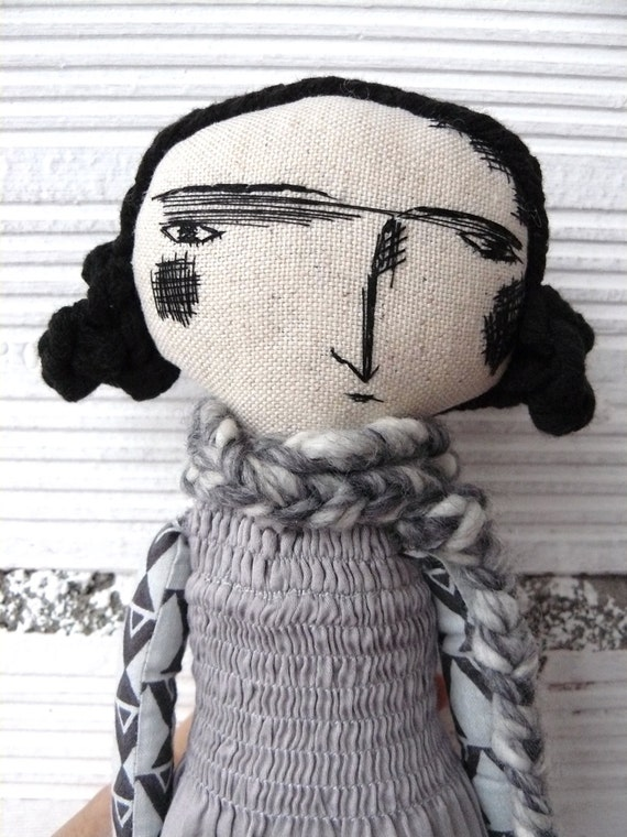 Art doll with black cotton hair. Embroidered face. 32 cm