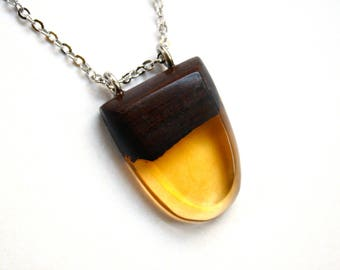 Little pendant / necklace handmade from dark Australian wood and orange coloured resin