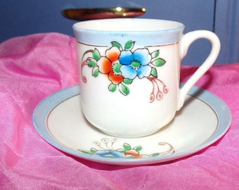 Small Delicate Porcelain Cup & Saucer