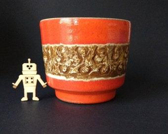 West German pottery planter, great orange and brown fat lava glaze, mid century modern, impressed pattern, funky retro piece, 1960s