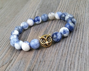 Bracelet on elastic made of stones sodalite 8mm and gold or silver owl