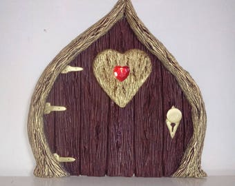 large fairy door with tiny metal key, Heart of the forest fairy door brown and gold.
