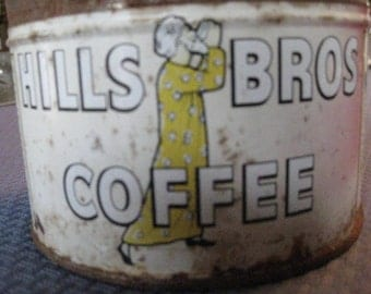 """Hills Brothers coffee tin; faded and rusty, but no holes!  3 """" high by 5 """" diameter. Old coffee tin for vintage decor; primitive and rustic"""