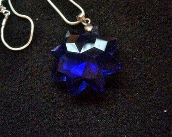 Blue Crystal star shaped pendant on silver tone necklace