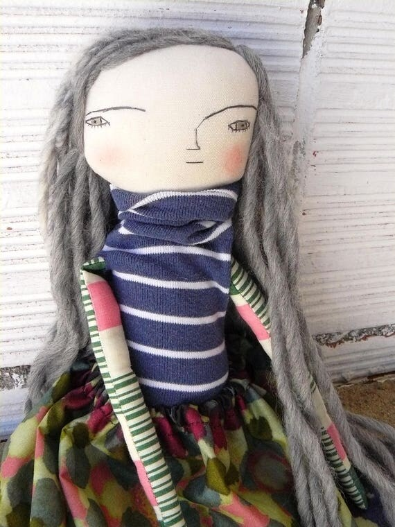Art doll with long pure wool hair and. Embroidered face. 32 cm.