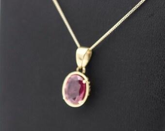 A Very Pretty Rubelite Pendant  On A Fine Gold Chain   SKU857