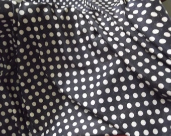 Black and Ivory Spot Fabric with an Embossed Paisley Design