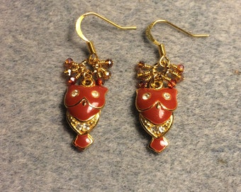 Burnt orange enamel and rhinestone owl charm earrings adorned with tiny dangling orange and amber Chinese crystal beads.