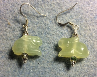 Light green new jade gemstone rabbit bead earrings adorned with olive green Chinese crystal beads.
