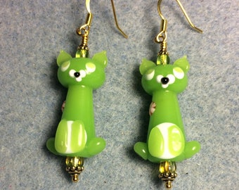 Opaque lime green lampwork cat bead earrings adorned with lime green Czech glass beads.