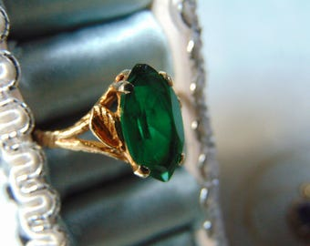 Beautiful Gold and Large Emerald Solitaire Ring Read Details