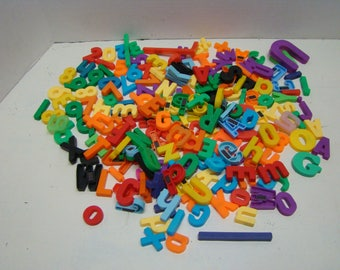 Not Fisher Price magnetic letters and numbers. Similar to FP. Over 150+ total (approx 120+ letters over 30 numbers) Almost all have magnet.
