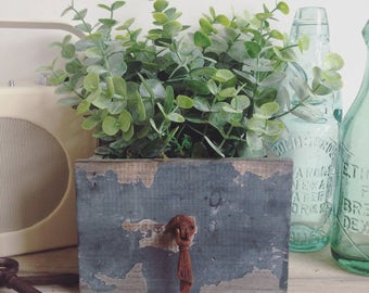 Rustic faux eucalyptus arrangement in vintage distressed planter