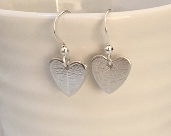 Heart earrings with delicate leaf texture