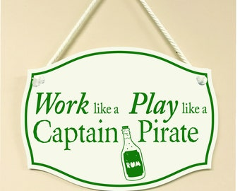 Work like a Captain, Play like a Pirate Hanging Sign