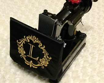 Protective sleeve for Featherweight sewing machine side drop panel with embroidered monogram