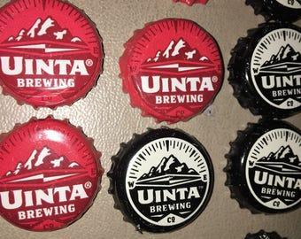 11 bottle caps from Uintas Craft Beer