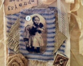 Mixed Media Collage of a little boy on tea-stained canvas, vintage fabric, old lace, burlap