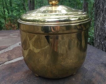 Brass ice bucket.  Heavy with ceramic liner.