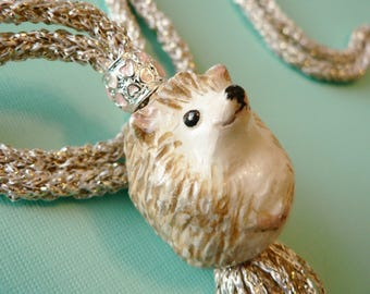 Long Tassel Hedgehog Necklace Hand Knitted in Pale Gold Metallic Yarn with Silver and Pink Hearts Bead and Handmade Hedgehog Pendant