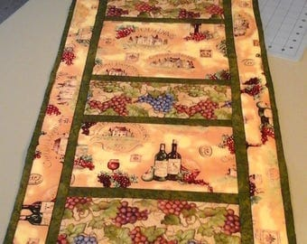 Machine quilted wine themed table runner
