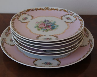 Set of 7 porcelain plates decorated in Limoge style 1960's flower decor