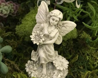 Miniature White Angel with a Flower