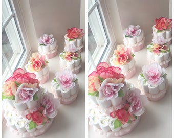 Flower diaper cake with matching centerpiece diaper cakes.  Beautiful decorations for a baby shower and the Mother-to-be takes home diapers!