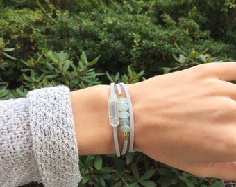 Wrap bracelet with genuine Quartz Crystal - grey suede lace -glass beads - gold accents