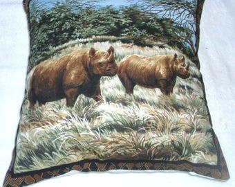 On Safari Rhinos walking across a grass plain cushion