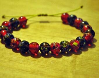Handmade bracelet with glass handmade beads and waxed thread!