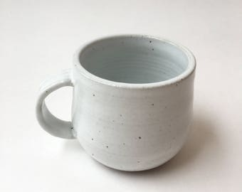 Freckled white stoneware mug